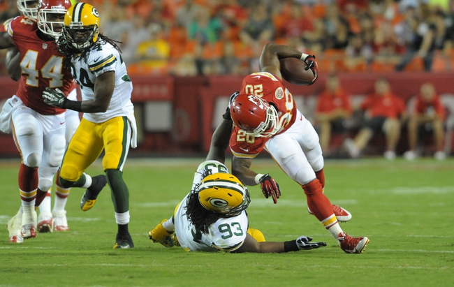 Aug 29, 2013; Kansas City, MO, USA; Kansas City Chiefs running back Shaun Draughn (20) is tackled by Green Bay Packers defensive end Josh Boyd (93) during the second half of the game at Arrowhead Stadium. The Chiefs won 30-8. Mandatory Credit: Denny Medley-USA TODAY Sports