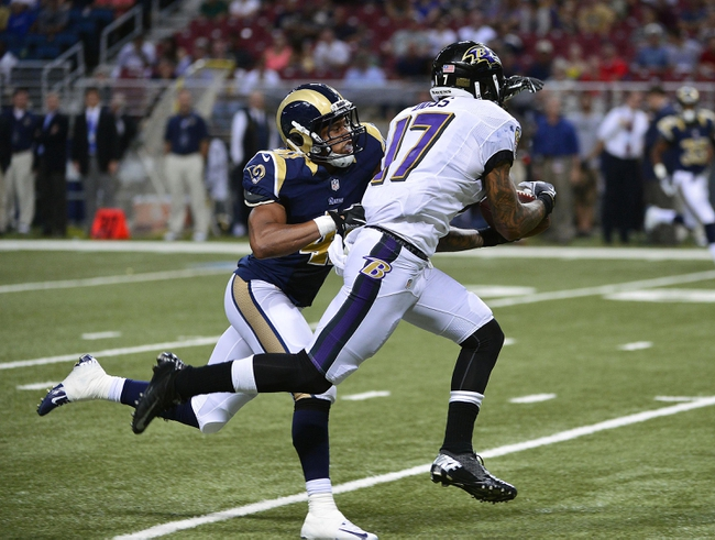 Aug 29, 2013; St. Louis, MO, USA; Baltimore Ravens wide receiver Tandon Doss (17) catches a 40 yard pass as St. Louis Rams defensive back Drew Thomas (41) defends during the second half at the Edward Jones Dome. The Rams defeated the Ravens 24-21. Mandatory Credit: Scott Rovak-USA TODAY Sports