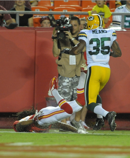Aug 29, 2013; Kansas City, MO, USA; Kansas City Chiefs wide receiver Rico Richardson (83) drops the ball as Green Bay Packers cornerback Loyce Means (35) defends during the second half of the game at Arrowhead Stadium. The Chiefs won 30-8. Mandatory Credit: Denny Medley-USA TODAY Sports