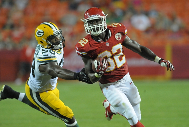 Aug 29, 2013; Kansas City, MO, USA; Kansas City Chiefs running back Cyrus Gray (32) runs the ball as Green Bay Packers linebacker Sam Barrington (58) attempt the tackle during the second half of the game at Arrowhead Stadium. The Chiefs won 30-8. Mandatory Credit: Denny Medley-USA TODAY Sports