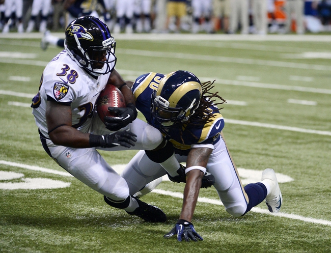 Aug 29, 2013; St. Louis, MO, USA; St. Louis Rams linebacker Ray-Ray Armstrong (50) tackles Baltimore Ravens running back Delone Carter (38) during the second half at the Edward Jones Dome. The Rams defeated the Ravens 24-21. Mandatory Credit: Scott Rovak-USA TODAY Sports