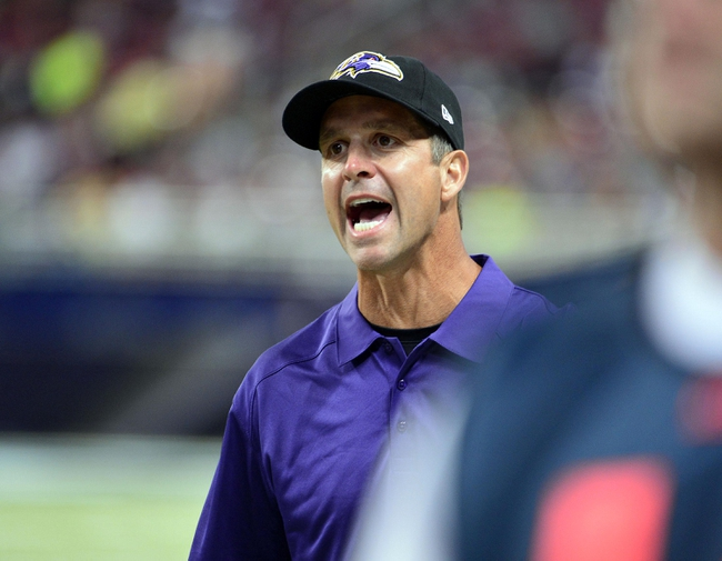 Aug 29, 2013; St. Louis, MO, USA; Baltimore Ravens head coach John Harbaugh yells towards a linesman during the second half against the St. Louis Rams at the Edward Jones Dome. The Rams defeated the Ravens 24-21. Mandatory Credit: Scott Rovak-USA TODAY Sports