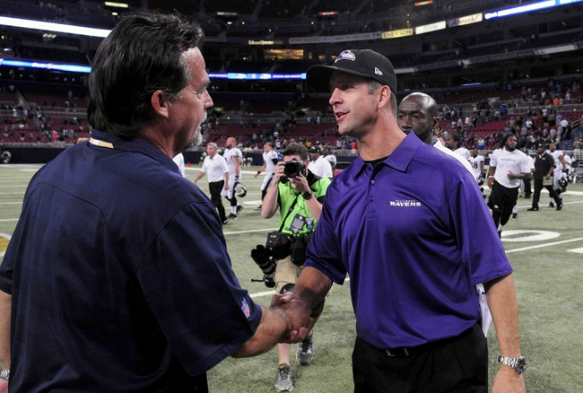 Aug 29, 2013; St. Louis, MO, USA; Baltimore Ravens head coach John Harbaugh shakes hands with St. Louis Rams head coach Jeff Fisher after a game at Edward Jones Dome. St. Louis defeated Baltimore 24-21. Mandatory Credit: Jeff Curry-USA TODAY Sports