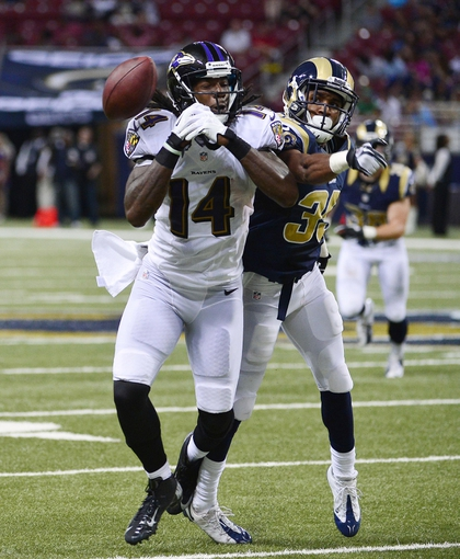 Aug 29, 2013; St. Louis, MO, USA; St. Louis Rams defensive back Darren Woodard (35) knocks the ball away from Baltimore Ravens wide receiver Marlon Brown (14) during the second half at the Edward Jones Dome. The Rams defeated the Ravens 24-21. Mandatory Credit: Scott Rovak-USA TODAY Sports