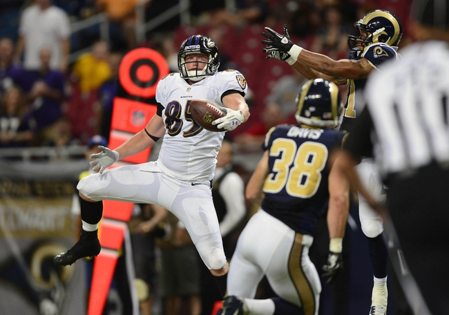 Aug 29, 2013; St. Louis, MO, USA; Baltimore Ravens tight end Matt Furstenburg (85) drops a pass that was intercepted by St. Louis Rams defensive back Drew Thomas (41) during the second half at Edward Jones Dome. St. Louis defeated Baltimore 24-21. Mandatory Credit: Jeff Curry-USA TODAY Sports