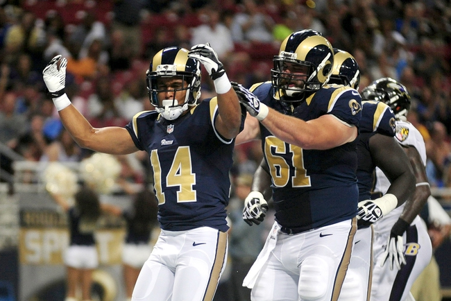 Aug 29, 2013; St. Louis, MO, USA; St. Louis Rams wide receiver Nick Johnson (14) celebrates after scoring a touchdown against the Baltimore Ravens during the second half at Edward Jones Dome. St. Louis defeated Baltimore 24-21. Mandatory Credit: Jeff Curry-USA TODAY Sports