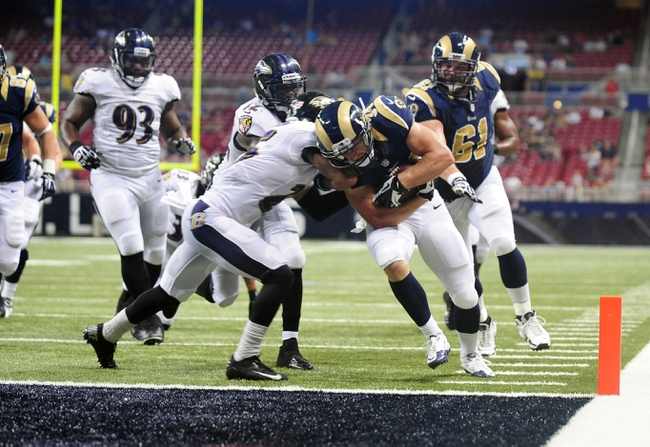 Aug 29, 2013; St. Louis, MO, USA; St. Louis Rams running back Chase Reynolds (34) scores the game winning touchdown against the Baltimore Ravens during the second half at Edward Jones Dome. St. Louis defeated Baltimore 24-21. Mandatory Credit: Jeff Curry-USA TODAY Sports