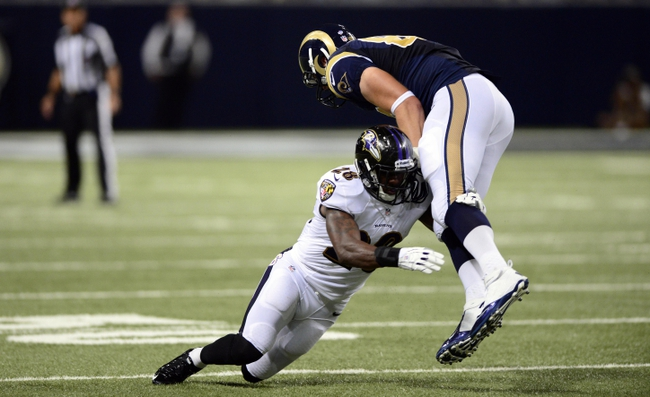 Aug 29, 2013; St. Louis, MO, USA; St. Louis Rams tight end Zach Potter (87) is tackled by Baltimore Ravens defensive back Brynden Trawick (28) during the second half at Edward Jones Dome. St. Louis defeated Baltimore 24-21. Mandatory Credit: Jeff Curry-USA TODAY Sports