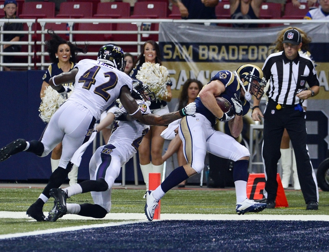 Aug 29, 2013; St. Louis, MO, USA; St. Louis Rams running back Chase Reynolds (34) scores on a 17 yard touchdown reception against the Baltimore Ravens during the second half at the Edward Jones Dome. The Rams defeated the Ravens 24-21. Mandatory Credit: Scott Rovak-USA TODAY Sports