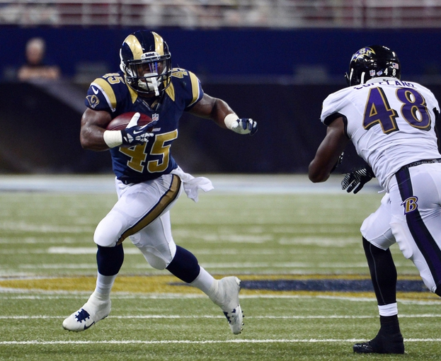 Aug 29, 2013; St. Louis, MO, USA; St. Louis Rams running back Benny Cunningham (45) rushes against the Baltimore Ravens during the second half at the Edward Jones Dome. The Rams defeated the Ravens 24-21. Mandatory Credit: Scott Rovak-USA TODAY Sports