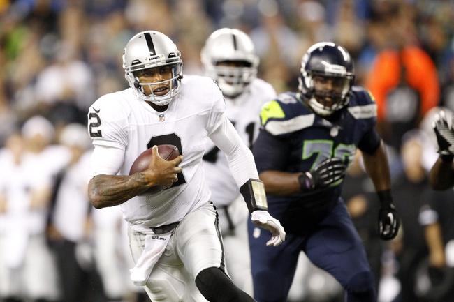 Aug 29, 2013; Seattle, WA, USA; Oakland Raiders quarterback Terrelle Pryor (2) rushes against the Seattle Seahawks during the second quarter at CenturyLink Field. Mandatory Credit: Joe Nicholson-USA TODAY Sports