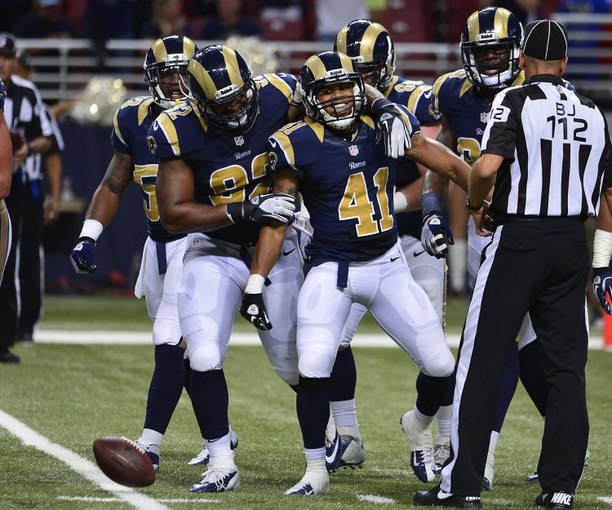 Aug 29, 2013; St. Louis, MO, USA; St. Louis Rams defensive back Drew Thomas (41) is congratulated after intercepting a pass against the Baltimore Ravens with 17 seconds left in the game at the Edward Jones Dome. The Rams defeated the Ravens 24-21. Mandatory Credit: Scott Rovak-USA TODAY Sports