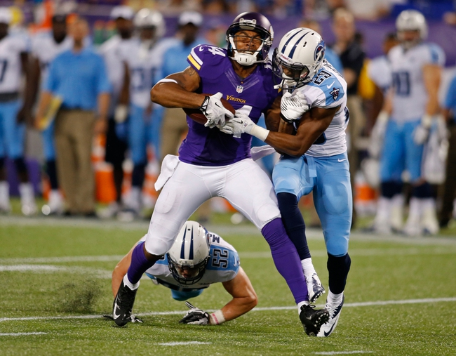 Aug 29, 2013; Minneapolis, MN, USA; Tennessee Titans cornerback Blidi Wreh-Wilson (29) hits Minnesota Vikings wide receiver Joe Webb (14) on a pass reception in the fourth quarter at Mall of America Field at H.H.H. Metrodome. Vikings win 24-23. Mandatory Credit: Bruce Kluckhohn-USA TODAY Sports
