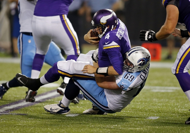 Aug 29, 2013; Minneapolis, MN, USA; Tennessee Titans defensive tackle Zach Clayton (69) sacks Minnesota Vikings quarterback McLeod Bethel-Thompson (4) in the third quarter at Mall of America Field at H.H.H. Metrodome. Vikings win 24-23. Mandatory Credit: Bruce Kluckhohn-USA TODAY Sports