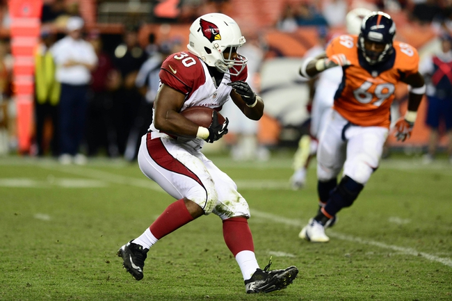 Aug 29, 2013; Denver, CO, USA; Arizona Cardinals running back Stepfan Taylor (30) during the third quarter of a preseason game against the Denver Broncos at Sports Authority Field. The Cardinals defeated the Broncos 32-24. Mandatory Credit: Ron Chenoy-USA TODAY Sports