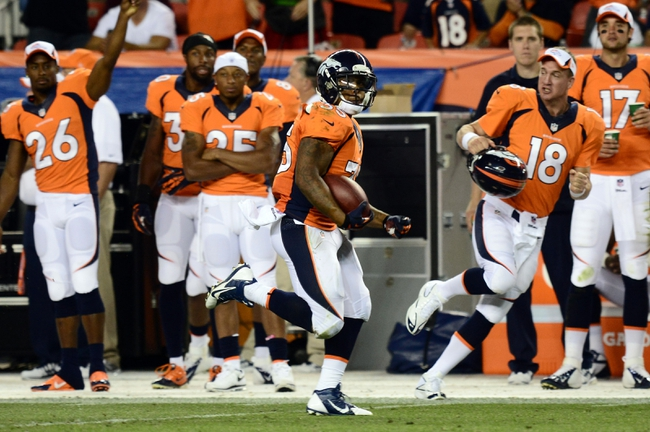 Aug 29, 2013; Denver, CO, USA; Denver Broncos running back Lance Ball (35) rushes during the third quarter of a preseason game against the Arizona Cardinals at Sports Authority Field. The Cardinals defeated the Broncos 32-24. Mandatory Credit: Ron Chenoy-USA TODAY Sports