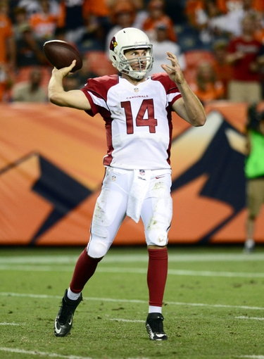 Aug 29, 2013; Denver, CO, USA; Arizona Cardinals quarterback Ryan Lindley (14) prepares to pass during the preseason game against the Denver Broncos at Sports Authority Field. The Cardinals defeated the Broncos 32-24. Mandatory Credit: Ron Chenoy-USA TODAY Sports