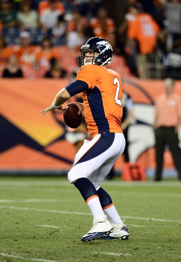 Aug 29, 2013; Denver, CO, USA; Denver Broncos quarterback Zac Dysert (2) prepares to pass during the fourth quarter of a preseason game against the Arizona Cardinals at Sports Authority Field. The Cardinals defeated the Broncos 32-24. Mandatory Credit: Ron Chenoy-USA TODAY Sports