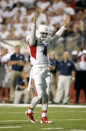 Aug 29, 2013; Fresno, CA, USA; Fresno State Bulldogs quarterback Derek Carr (4) celebrates after the Bulldogs scored a touchdown against the Rutgers Scarlet Knights in the second quarter at Bulldog Stadium. Mandatory Credit: Cary Edmondson-USA TODAY Sports