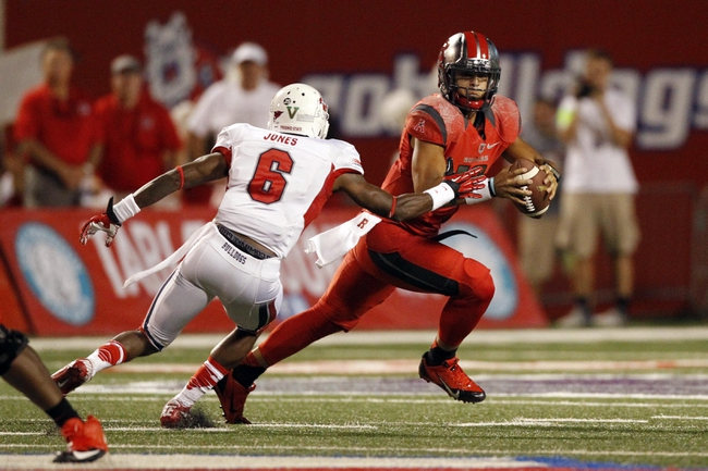 Aug 29, 2013; Fresno, CA, USA; Rutgers Scarlet Knights quarterback Gary Nova (10) avoids Fresno State Bulldogs defensive back L.J. Jones (6) in the second quarter at Bulldog Stadium. Mandatory Credit: Cary Edmondson-USA TODAY Sports