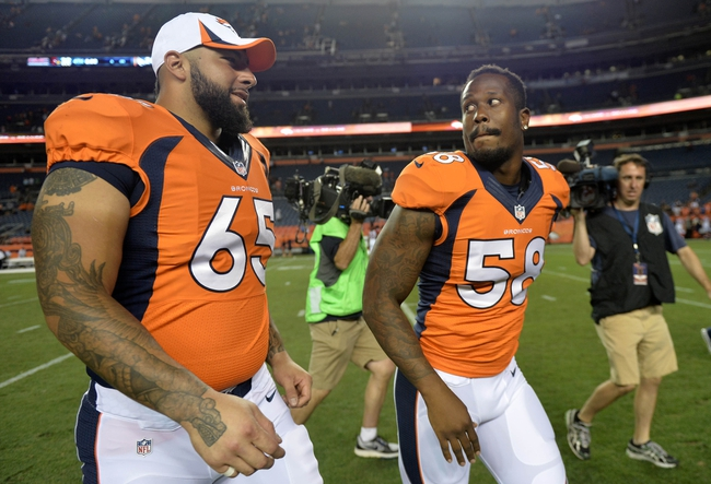 Aug 29, 2013; Denver, CO, USA; Denver Broncos outside linebacker Von Miller (58) and offensive guard Justin Boren (65) following the end of the preseason game against the Arizona Cardinals at Sports Authority Field. The Cardinals defeated the Broncos 32-24. Mandatory Credit: Ron Chenoy-USA TODAY Sports