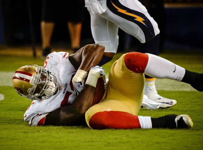Aug 29, 2013; San Diego, CA, USA; San Francisco 49ers linebacker Cam Johnson (50) recovers a blocked punt in the end zone for a touchdown during second half action against the San Diego Chargers at Qualcomm Stadium.