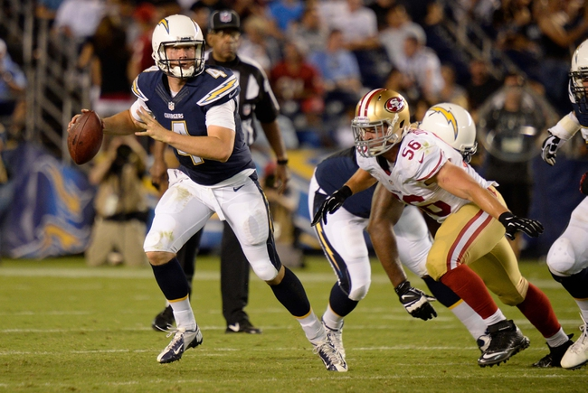 Aug 29, 2013; San Diego, CA, USA; San Diego Chargers quarterback Brad Sorensen (4) is chased out of the pocket by San Francisco 49ers linebacker Travis Johnson (56) during fourth quarter action at Qualcomm Stadium.
