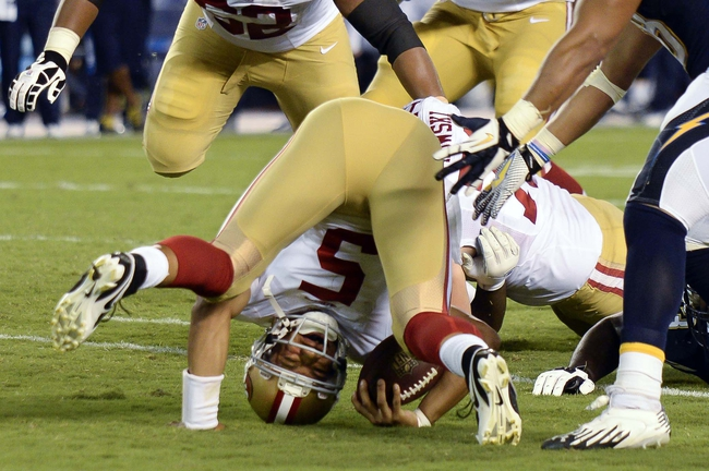 Aug 29, 2013; San Diego, CA, USA; San Francisco 49ers quarterback B.J. Daniels (5) is upended for a 1-yard loss during the fourth quarter against the San Diego Chargers at Qualcomm Stadium. Mandatory Credit: Robert Hanashiro-USA TODAY