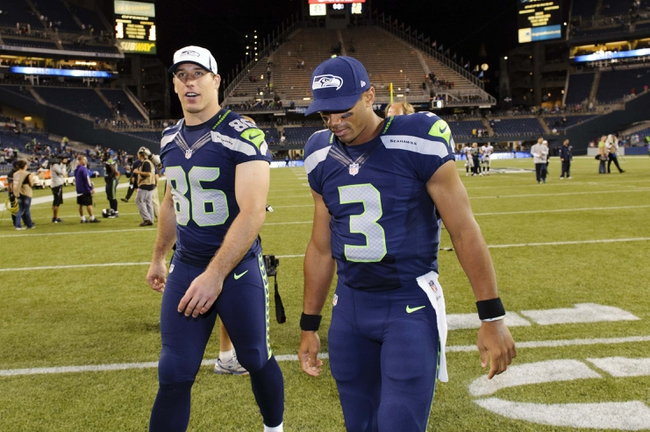 Aug 29, 2013; Seattle, WA, USA; Seattle Seahawks tight end Zach Miller (86) and quarterback Russell Wilson (3) walk off the field after the game against the Oakland Raiders at CenturyLink Field. Seattle defeated Oakland 22-6. Mandatory Credit: Steven Bisig-USA TODAY Sports