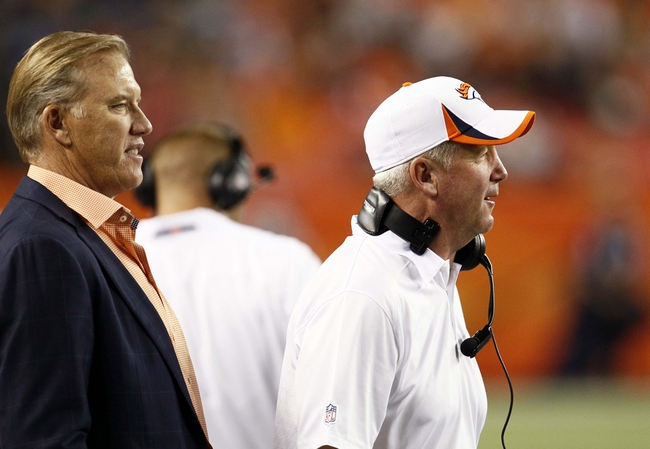 Aug 29, 2013; Denver, CO, USA; Denver Broncos head coach John Fox and vice president of football operations John Elway (left) in the fourth quarter against the Arizona Cardinals at Sports Authority Field at Mile High. The Cardinals won 32-24. Mandatory Credit: Isaiah J. Downing-USA TODAY Sports