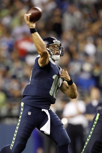 Aug 29, 2013; Seattle, WA, USA; Seattle Seahawks quarterback Brady Quinn (10) passes against the Oakland Raiders during the second half at CenturyLink Field. Mandatory Credit: Joe Nicholson-USA TODAY Sports