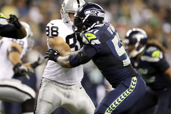 Aug 29, 2013; Seattle, WA, USA; Seattle Seahawks defensive end Bruce Irvin (51) is blocked by Oakland Raiders tight end Nick Kasa (88) during the second half at CenturyLink Field. Mandatory Credit: Joe Nicholson-USA TODAY Sports