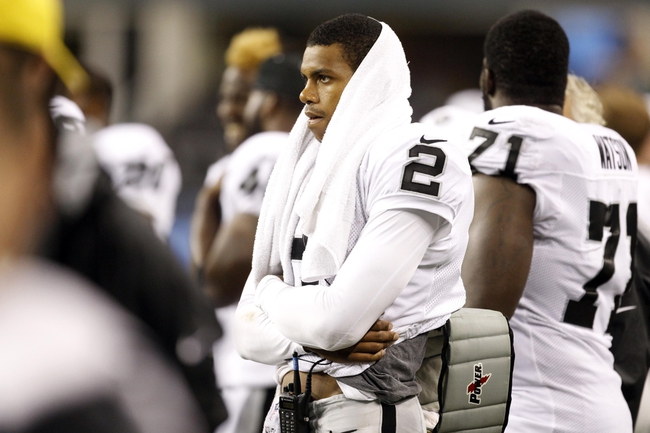 Aug 29, 2013; Seattle, WA, USA; Oakland Raiders quarterback Terrelle Pryor (2) watches from the sideline during the second half against the Seattle Seahawks at CenturyLink Field. Mandatory Credit: Joe Nicholson-USA TODAY Sports