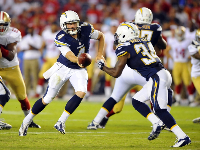 Aug 29, 2013; San Diego, CA, USA; San Diego Chargers quarterback Brad Sorensen (4) turns to hand the ball to running back Fozzy Whittaker (34) during the second half against the San Francisco 49ers at Qualcomm Stadium. Mandatory Credit: Christopher Hanewinckel-USA TODAY Sports