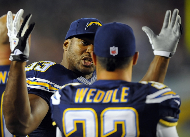 Aug 29, 2013; San Diego, CA, USA; San Diego Chargers linebacker Dwight Freeney (93) talks with safety Eric Weddle (32) on the sidelines during the second half against the San Francisco 49ers at Qualcomm Stadium. Mandatory Credit: Christopher Hanewinckel-USA TODAY Sports