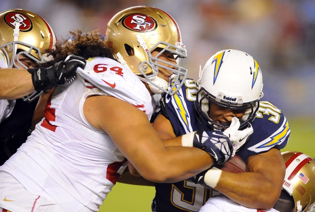 Aug 29, 2013; San Diego, CA, USA; San Diego Chargers running back Michael Hill (30) is tackled by San Francisco 49ers nose tackle Mike Purcell (64) after a short gain during the second half at Qualcomm Stadium. Mandatory Credit: Christopher Hanewinckel-USA TODAY Sports