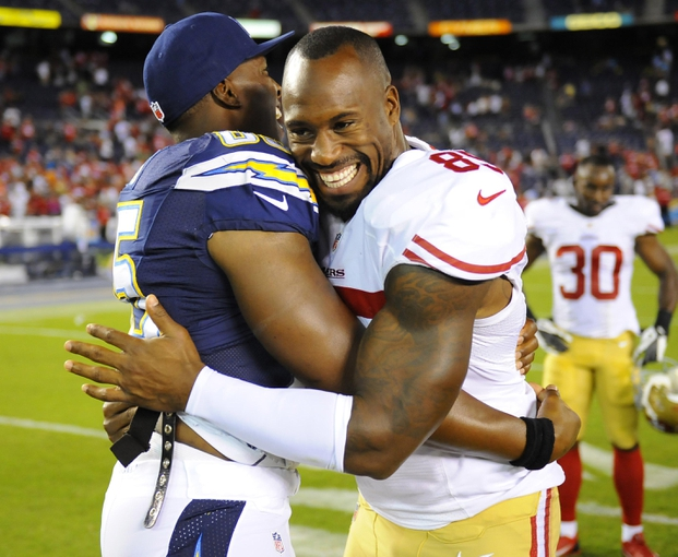 Aug 29, 2013; San Diego, CA, USA; San Diego Chargers tight end Antonio Gates (left) and San Francisco 49ers tight end Vernon Davis (85) embrace after a 41-6 49ers win at Qualcomm Stadium. Mandatory Credit: Christopher Hanewinckel-USA TODAY Sports