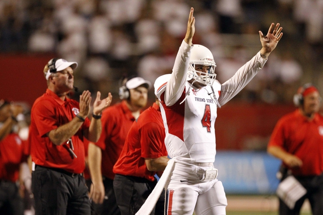 Aug 29, 2013; Fresno, CA, USA; Fresno State Bulldogs quarterback Derek Carr (4) reacts after the Bulldogs kicked an extra point against the Rutgers Scarlet Knights in the fourth quarter at Bulldog Stadium. The Bulldogs defeated the Scarlet Knights 52-51 in overtime. Mandatory Credit: Cary Edmondson-USA TODAY Sports