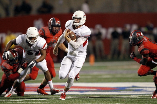 Aug 29, 2013; Fresno, CA, USA; Fresno State Bulldogs quarterback Derek Carr (4) runs with the ball against the Rutgers Scarlet Knights in the third quarter at Bulldog Stadium. The Bulldogs defeated the Scarlet Knights 52-51 in overtime. Mandatory Credit: Cary Edmondson-USA TODAY Sports