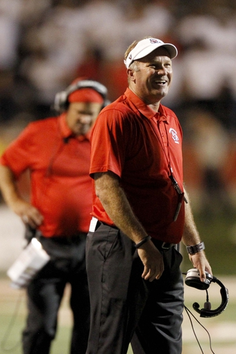 Aug 29, 2013; Fresno, CA, USA; Fresno State Bulldogs head coach Tim DeRuyter stands on the field against the Rutgers Scarlet Knights in the fourth quarter at Bulldog Stadium. The Bulldogs defeated the Scarlet Knights 52-51 in overtime. Mandatory Credit: Cary Edmondson-USA TODAY Sports