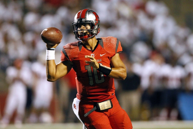 Aug 29, 2013; Fresno, CA, USA; Rutgers Scarlet Knights quarterback Gary Nova (10) looks to pass the ball against the Fresno State Bulldogs in the third quarter at Bulldog Stadium. The Bulldogs defeated the Scarlet Knights 52-51 in overtime. Mandatory Credit: Cary Edmondson-USA TODAY Sports