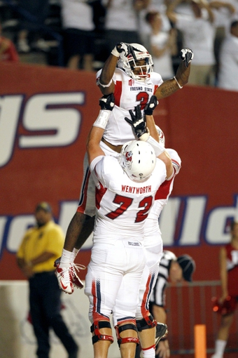 Aug 29, 2013; Fresno, CA, USA; Fresno State Bulldogs wide receiver Josh Harper (3) celebrates with offensive lineman Austin Wentworth (72) after catching a touchdown against the Rutgers Scarlet Knights in the third quarter at Bulldog Stadium. The Bulldogs defeated the Scarlet Knights 52-51 in overtime. Mandatory Credit: Cary Edmondson-USA TODAY Sports