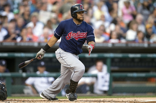 Aug 30, 2013; Detroit, MI, USA; Cleveland Indians designated hitter Carlos Santana (41) hits a double during the second inning against the Detroit Tigers at Comerica Park. Mandatory Credit: Rick Osentoski-USA TODAY Sports