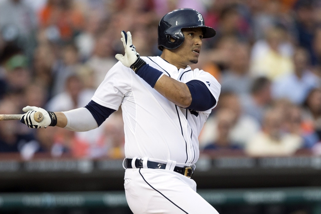 Aug 30, 2013; Detroit, MI, USA; Detroit Tigers designated hitter Victor Martinez (41) hits a double second inning against the Cleveland Indians at Comerica Park. Mandatory Credit: Rick Osentoski-USA TODAY Sports