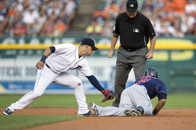 Aug 30, 2013; Detroit, MI, USA; Cleveland Indians catcher Carlos Santana (41) is safe at second for a double ahead of the tag by Detroit Tigers shortstop Jose Iglesias (1) during the second inning at Comerica Park. Mandatory Credit: Rick Osentoski-USA TODAY Sports