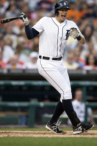 Aug 30, 2013; Detroit, MI, USA; Detroit Tigers left fielder Don Kelly (32) reacts to fouling a ball off his foot during the second inning against the Cleveland Indians at Comerica Park. Mandatory Credit: Rick Osentoski-USA TODAY Sports