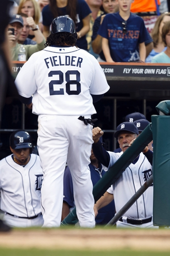 Aug 30, 2013; Detroit, MI, USA; Detroit Tigers first baseman Prince Fielder (28) receive congratulation from manager Jim Leyland (10) after scoring during the second inning against the Cleveland Indians at Comerica Park. Mandatory Credit: Rick Osentoski-USA TODAY Sports