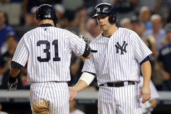 Aug 30, 2013; Bronx, NY, USA; New York Yankees right fielder Ichiro Suzuki (31) is congratulated by New York Yankees first baseman Mark Reynolds (39) after hitting a two run home run against the Baltimore Orioles during the fifth inning of a game at Yankee Stadium. Mandatory Credit: Brad Penner-USA TODAY Sports
