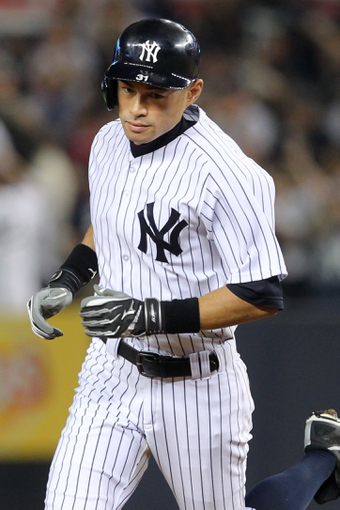 Aug 30, 2013; Bronx, NY, USA; New York Yankees right fielder Ichiro Suzuki (31) rounds the bases after hitting a two run home run against the Baltimore Orioles during the fifth inning of a game at Yankee Stadium. Mandatory Credit: Brad Penner-USA TODAY Sports