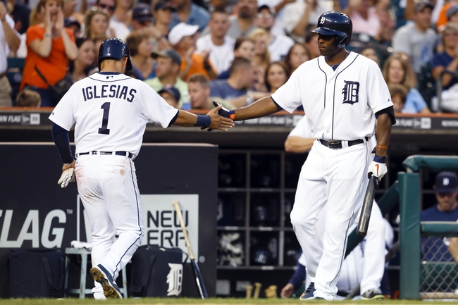 Aug 30, 2013; Detroit, MI, USA; Detroit Tigers shortstop Jose Iglesias (1) receive congratulation from Detroit Tigers right fielder Torii Hunter (48) after scoring during the third inning against the Cleveland Indians at Comerica Park. Mandatory Credit: Rick Osentoski-USA TODAY Sports